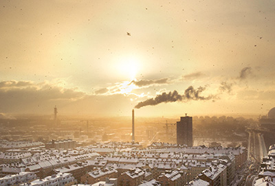 An industrial city scene with smoke flowing from chimnies